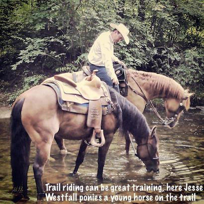 Jesse trail riding while leading a young horse